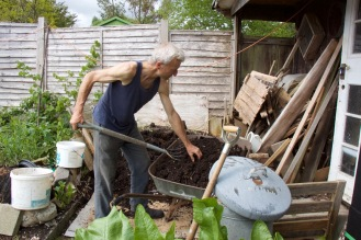 Charles filling a barrow