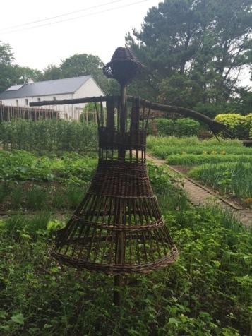 Female scarecrow in the small kitchen garden